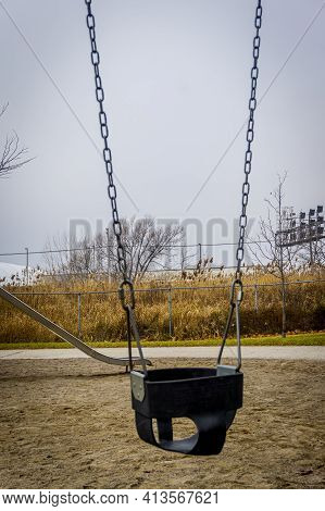 Empty Swing In A Deserted Playground Can Illustrate A Covid Lockdown Situation Where Kids Are Not Al