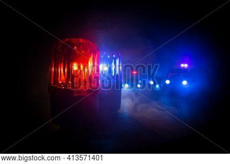 Police Car Blue And Red Round Vintage Siren In Dark. Rotating Retro Style Police Siren In Dark.
