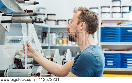 an checking quality of labels in printing shop