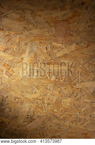 Aged osb wooden background of table or wall texture. Chipboard wood background with copy space