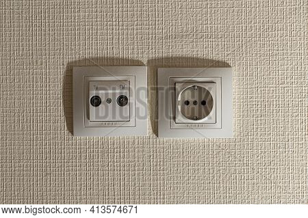 Socket And Socket For The Tv Antenna Cable On The Beige Wall