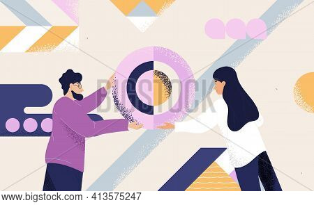 Concept Of Organisation With Two People Working As A Team Arranging Abstract Geometric Shapes Into A