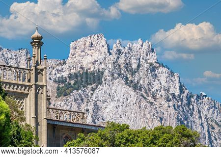 The Walls And Towers Of The Old Palace On The Background Of High Mountains And Blue Sky. Vorontsov P