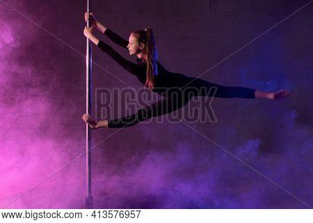 Slim Teen Pole Dancer Performing Aerial Splits