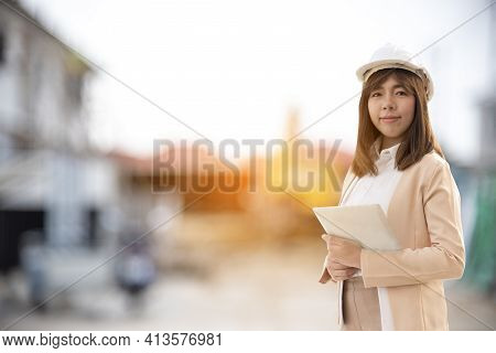 Woman Construction Engineer Wear Safety White Hard Hat At Construction Site Industry Worker. Female