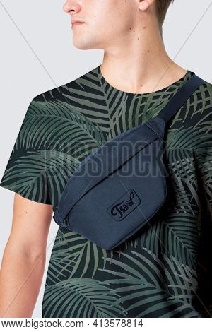 Sporty man with color bum bag with logo streetwear studio shoot