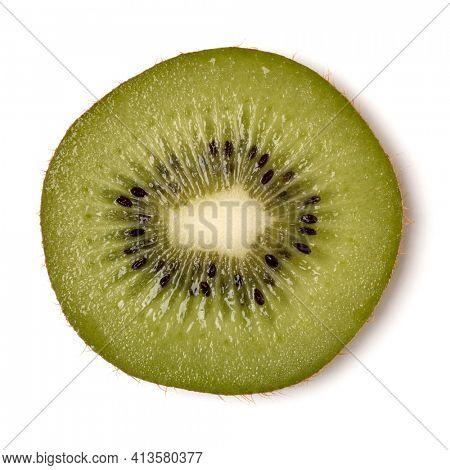 One kiwi fruit slice isolated over white background closeup. Kiwifruit slice flatlay. Flat lay, top view.