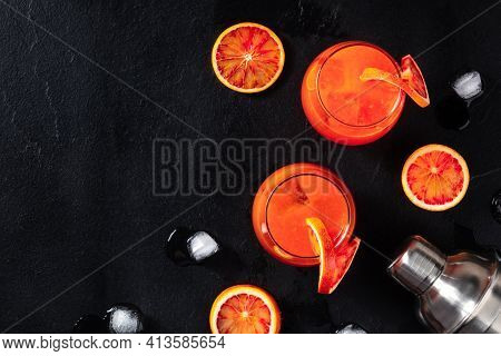 Campari Orange Cocktails, Shot From The Top On A Black Background