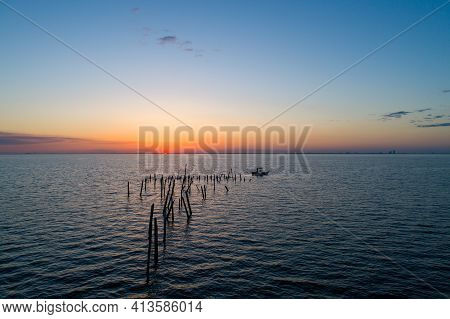Boats On Mobile Bay, Alabama At Sunset In March Of 2021