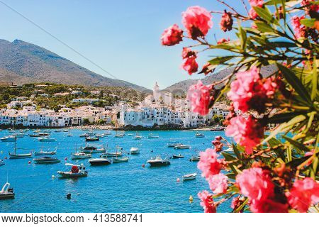 Mediterranean Coast. White Houses, Turquose Sea And Yachts. Cadaqués Village On The Mediterranean Se
