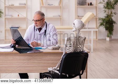 Dead patient visiting old male doctor radiologist