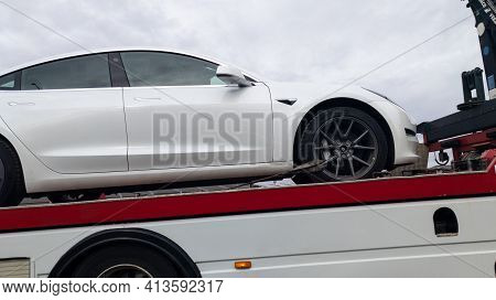 Bordeaux , Aquitaine France - 03 18 2021 : Tesla Broken Down Car On A Flatbed Truck Heading To The G