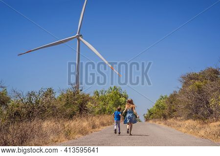 Alternative Energy, Wind Farm And Happy Time With Your Family. Happy Mother On The Road With His Son