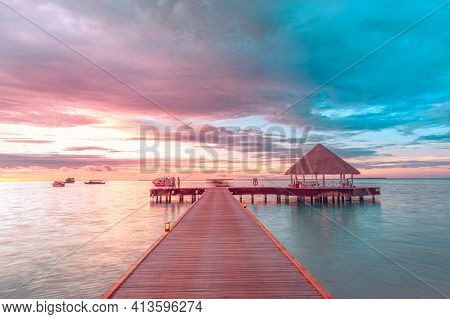 Over Water Bungalows With Steps Into Amazing Ocean Lagoon. Sea Horizon, Colorful Cloudy Sky. Water V