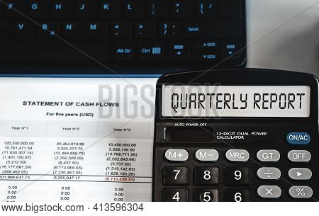 Quarterly Report - Concept Of Text On Calculator Display. Business, Tax And Financial Concept