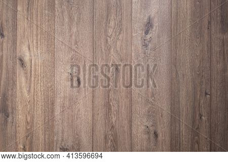 Laminated wooden floor surface background or wall texture.  Brown wood laminate floor with copy space