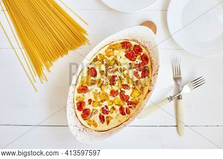 Trending Viral Recipe Of Baked Tomatoes And Feta With Pasta, Fetapasta On A White Wooden Background