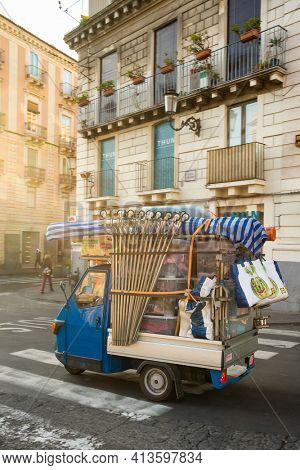 Catania, Sicily - March 5, 2020: Old Piaggio Ape, a three-wheeled light commercial vehicle driving at the streets of Catania in Sicily