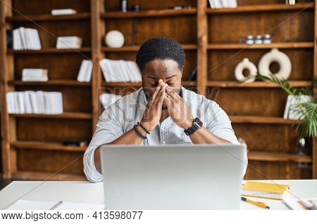 Desperate And Tired Young African-american Businessman Entrepreneur In Smart Casual Attire, Touching