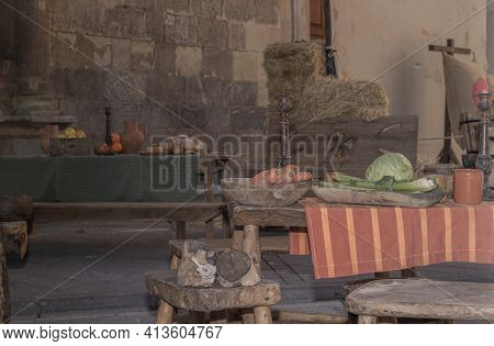 Medieval Tavern With Tables, Benches And Utensils Of The Time