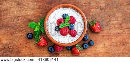 Chia Seed Pudding Made With Fresh Berries On Wooden Table.  Chia Seeds Yogurt. Top View. Copyspace