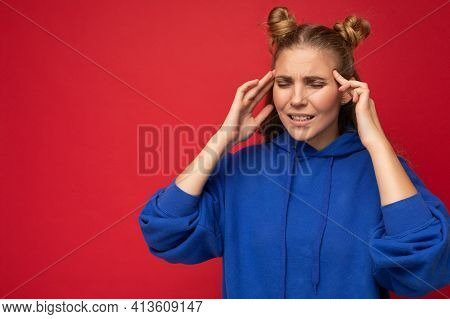 Photo Of Tired Weary Young Beautiful Blonde Woman With Two Horns With Sincere Emotions Wearing Hipst