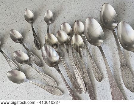 Vintage Spoons Collection Isolated On White Granite Background. Retro Silverware.