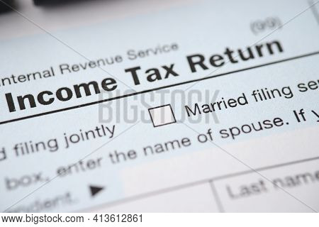 Document With The Income Tax Form Is On Table