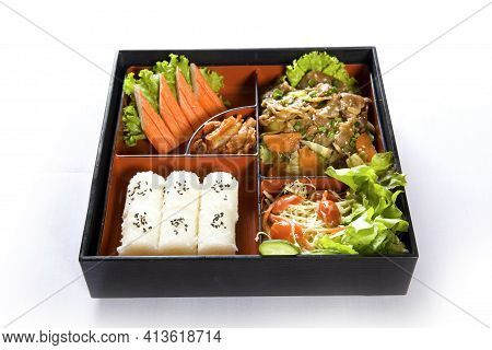 Japanese Style Lunch Bento Box With Various Vegetable And Meat On White Background.