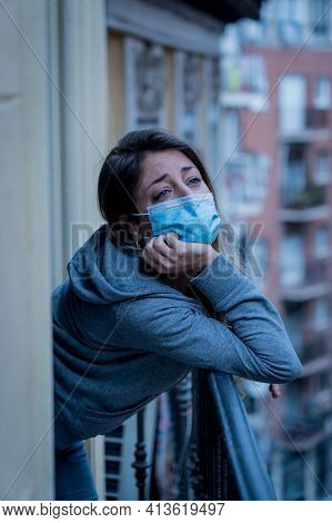 Young Beautiful Unhappy Woman With Face Mask Suffering From Depression Due To Isolation