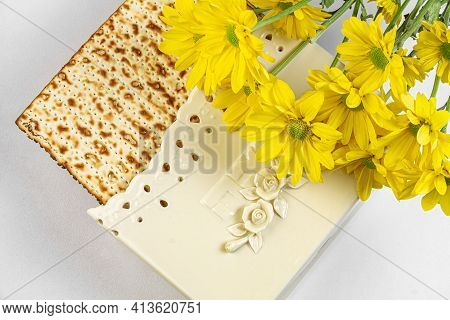 Pesach Background With Matzo And Yellow Chrysanthemums. Jewish Holiday. View From Above. Passover (p