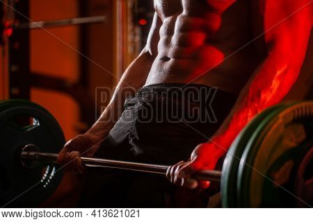 Close Up Training With Barbell. Man Lifting Barbells Working Out In Gym. Closeup Deadlift Barbells W