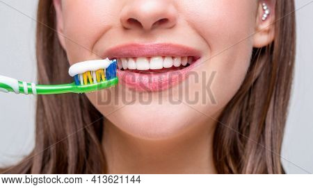 Dental Health Background. Close Up Of Perfect And Healthy Teeth With Toothbrush. Portrait Of A Smili