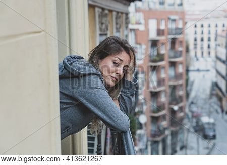 Young Beautiful Woman Looking Sad And Depressed On A Balcony In A Depression Concept.