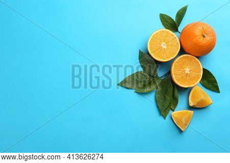 Delicious Oranges On Light Blue Background, Flat Lay. Space For Text