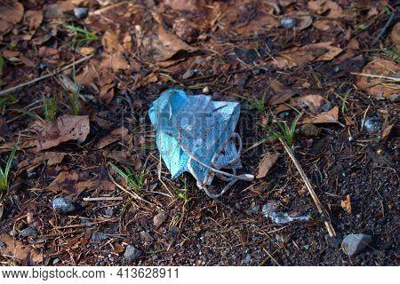 Thrown Away Mask On The Ground In A Forest In Vaduz In Liechtenstein 17.2.2021