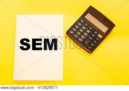 Sem On Yellow Background In Office Desk