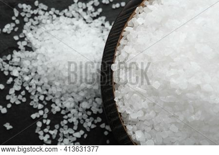 Plate With Natural Sea Salt On Black Table, Closeup. Space For Text