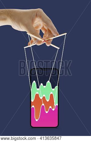 Businessman Keeping The Growth In Economy, Manipulating Graphs Like Puppet