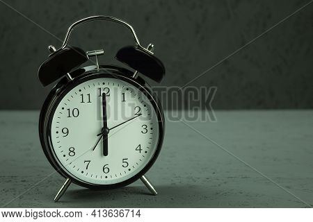 Alarm Clock On Which Six O'clock. Clock In Vintage Style, 6 Am, On A Dark Wooden Background. Copy Sp