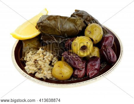 Stuffed Vine Leaves Filled With Rice And Herbs And Mixed Mediterranean Olives On A Small Plate Isola