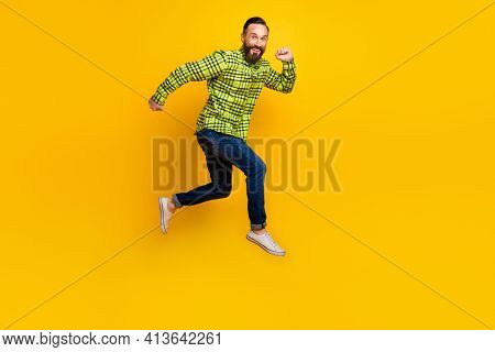 Full Body Profile Side Photo Of Man Happy Positive Smile Go Walk Run Jump Hurry Isolated Over Yellow