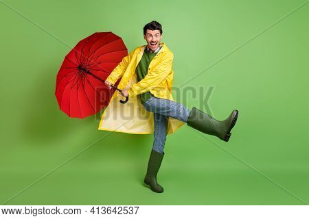 Full Size Photo Of Young Happy Excited Good Mood Crazy Man Dancing With Umbrella In Hands Isolated O