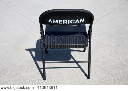 Metal Folding Chair. A classic black metal folding chair. Folding chairs are used for all types of events and gatherings. They fold closed for easy storage and transportation.