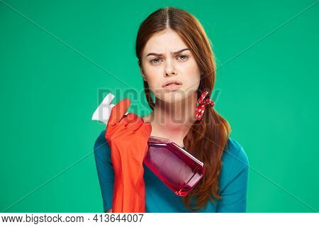 Emotional Cleaning Lady With Detergent Rubber Gloves Displeasure Green Background