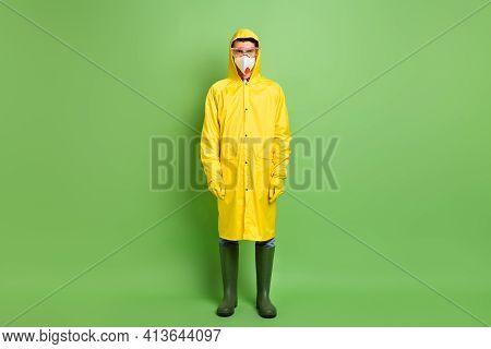 Full Length Body Size View Of Serious Guy Wearing Raincoat Anti Bio Hazard Equipment N95 Mask Isolat