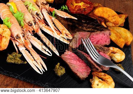 Surf And Turf Meal With Sirloin Steak, Langoustine And Tiger Prawns