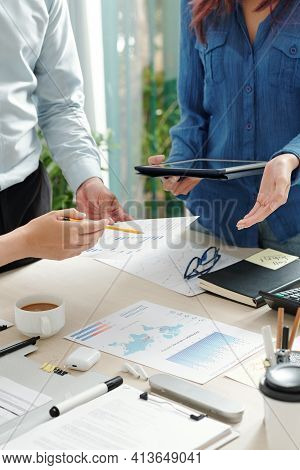 Cropped Image Of Business People Checking Various Charts And Reports At Meeting And Discussing Busin
