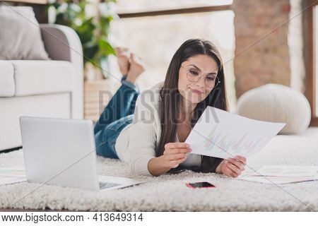 Photo Of Smart Business Lady Lay Carpet Netbook Hold Document Read Wear Glasses White Sweater In Liv