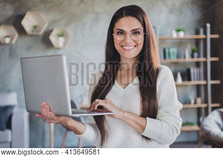 Photo Of Successful Lady Hold Netbook Look Camera Beaming Smile Wear Glasses White Sweater In Living